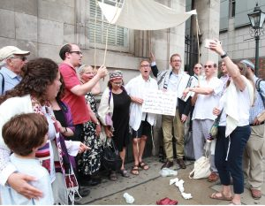 Progressive Rabbis stand under a wedding canopy outside the Israeli Embassy.