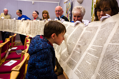 Members of Kol Chai Hatch End Reform Community with their Torah scroll