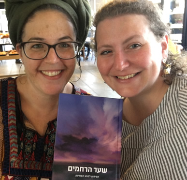 Nili Arbel and Rabbi Debbie Young-Somers with a copy of 'Gates of Mercy', a collection of prayers and rituals for those on journeys of infertility
