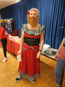 A photograph of one attendee as a bearded lady